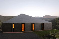 Prefab Swiss Alps House Designed to Look Like Boulder