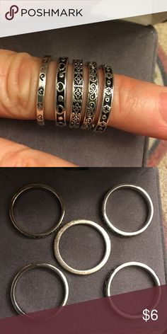 Silver Rings Set of 5 New, never used Silver Rings Set of 5. Have been cleaned. Size 6 Jewelry Rings