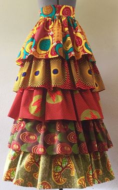 Get the low-down on where to find the most breathtaking African print skirt right now. Plus everything you need to know about wax print, ankara fabric and how to score African print skirts at a fract African Dresses For Women, African Attire, African Fashion Dresses, African Wear, African Women, African Style, Ankara Fashion, Fashion Skirts, Fashion Outfits