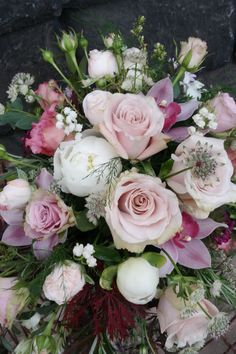 Lilac and dusky pink rose and orchid cascade bouquet