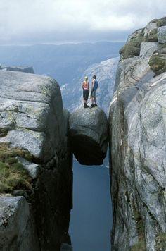 Kjeragbolten boulder wedged in a mountain crevice in the Kjerag mountains in Norway.