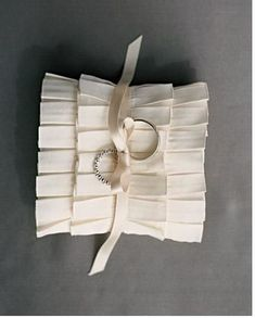 Ruffled Ring Pillow, tailor a ring pillow out of box-pleated satin ribbons. The Details: Rings, Memoire; pleated ribbon, M&J Trimming. Ring Pillow Wedding, Wedding Pillows, Wedding Ring, Ring Bearer Pillows, Ring Pillows, Wedding Themes, Diy Wedding, Wedding Ideas, Wedding Bells