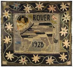antique hooked rug. love the border and color