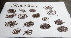 Filigranas, letras, hojas, cuencos y tejas de chocolate