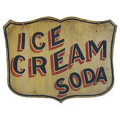 Ice Cream Soda Sign  USA  Circa 1930  Circa 1930 shield shaped double sided tin sign 'Ice Cream Soda' with professional black and red lettering on a mustard ground, as found surface and condition