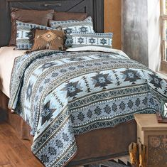 A Lone Star Western Décor Exclusive - Twilight desert tones add a calming touch to this polyester bedding featuring southwestern geometric patterns. Sets include quilt and two shams. Machine wash.