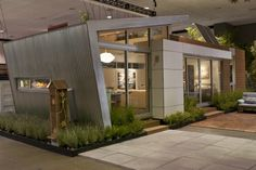 This is the Modern Living Showhouse on display at Dwell on Design The green prefab was designed by Jonathan Davis of pieceHomes, built by OneBuild Inc., and styled by Zem Joaquin and ecofabulous. Modern Mobile Homes, Modern Modular Homes, Modular Home Plans, Dwell On Design, Modern Design, Modern Contemporary, Studios Architecture, Modern Architecture, Residential Architecture