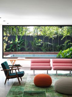 White, teak, house plants. Simple and beautiful  A Mid-Century Classic In São Paulo. Brazilian architect Guilherme Torres.