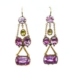 Pair of antique pink topaz and chrysolite pendant earrings, c.1800,  designed as an oblong topaz below two oval cut topaz and with single stone top, a small oval chrysolite hung within, each tier suspended on chains, close cut-down collet set in gold  Length 5cm / 2''