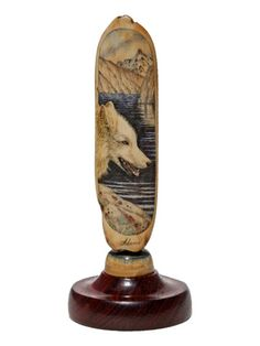 """White Wolf"" Color Scrimshaw on Ancient Walrus Tusk Ivory by David Adams -- on ScrimshawGallery.com #scrimshaw"