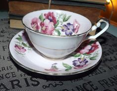 Mid-century (c.1950s) Windsor Bone China hand-painted tea set (flat cup w/saucer).  Pink, purple flowers, pink ground, gold edge + accents.