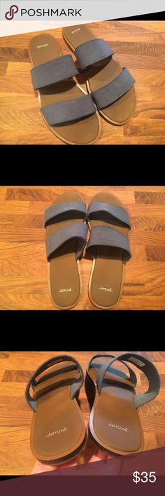 Sanuk sandals! Loooove these awesome pair of sanuks that I purchased at a beach boutique last summer. Only wore a few times. Hate to part with them! Alas...I'm more of a 10.5 than a 10. These fit more like a 9.5-10. These are a lovely woven heathered blue, with brown footbed and sole. As is the Sanuk way, comfort meets style! Questions? Sanuk Shoes Sandals