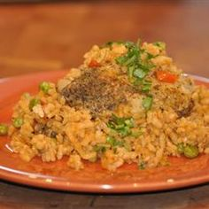 """Arroz con Pollo II  Recipe bySussell """"This recipe is an all in one. This was a family favorite while I was growing up and I believe it still is one of my favorites. It's simply chicken and rice with fabulous Cuban flavours! This recipe is quick and easy and can be served with a salad, fried plantains or even a banana - a Cuban favorite with any meal!"""""""