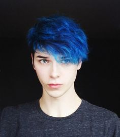 blue curly hair, with long bangs falling over one eye, long hairstyles for boys, on teenager in dark grey t-shirt Hairstyles For Teenage Guys, Cool Boys Haircuts, Teen Boy Haircuts, Boys Long Hairstyles, Haircuts For Men, Braided Hairstyles, Mens Blue Hair, Dark Blue Hair, Guys With Blue Hair