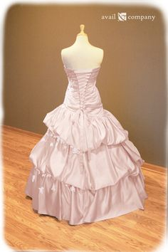 Blush Pink Wedding Dress - Angela Style - Avail & Company, LLC  This gorgeous dress is made of blush pink matte satin with a drop waist and ruched bodice. The dress displays bead work(clear beads and pearls) and lace. The back features corset styled lacing. The dress can also come with attachable straps and a train.
