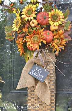 Using faux floral bushes is a super easy and affordable way to create a fall wreath or hanging basket for your door. #fall #fallwreath #falldecor || Worthing Court
