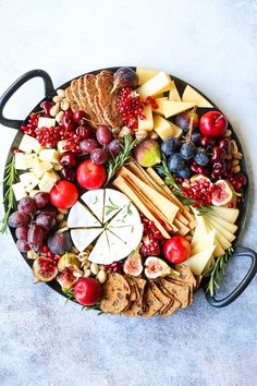 Holiday Cheese Board – The most EPIC appetizer board ever! With an assortment of… Holiday Cheese Board – The most EPIC appetizer board ever! With an assortment of cheeses, figs, nuts, and pomegranate, this is the must-have holiday recipe! Best Holiday Appetizers, Healthy Holiday Recipes, Holiday Parties, Plateau Charcuterie, Charcuterie Board, Charcuterie Cheese, Tapas, Party Food Platters, Snack Platter