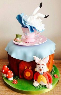 Alice in wonderland cake - this funny, clever cake is sure to cause laughter and merriment at your next birthday party. Mad Hatter Cake, Mad Hatter Tea, Alice In Wonderland Birthday, Alice In Wonderland Tea Party, Fondant, Tea Party Birthday, Birthday Cake, Character Cakes, Disney Cakes