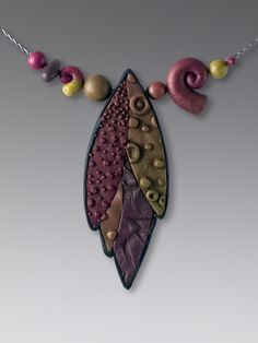 Laura Tabakmen textured pendant   Flickr - Photo Sharing! So pretty! #pendantnecklace