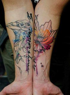 Forearm hawk & flower watercolor tattoo