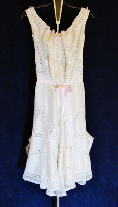Heres an absolutely fabulous, rare piece of ladies lingerie from about 1900, a combination corset cover and open drawers made from ivory silk and