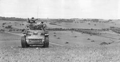 An M5A1 shepherds a mechanised infantry company in half-tracks on the fields near Buchet, France, 31 August 1944. The tank is from Company A, 66th Armored Regiment, which means the infantry company is probably from 41st AIR, also in 2nd Armored Division.