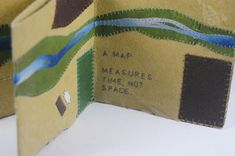 The Myth of Mapping by Roberta Lavadour. Unique Artist Book.  short piece about mapping is stitched into the paper, that when unfolded reveals the aerial view of the landscape beyond the studio window. Flax paper from Cave Paper in a boustrophedon accordion with appliqued stitched paper. Limp paper enclosure. 5.5 x 5.75 x 1.5 inches. Unique. 2010.