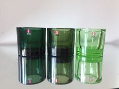 3 candleholders in green colors Designed by Heikki Orvola in 1988 6 cm tall and 6 cm wide In very good used condition Marimekko is embissed on the base Marimekko, Green Colors, Candle Holders, Conditioner, Water Bottle, How To Make, Etsy, Vintage, Design