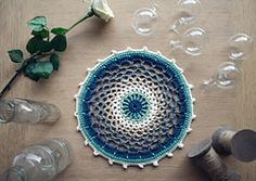 It's chilly outside and all the colours have a blue haze over them… Time to celebrate with a new mandala design! Inspired by wintery things, this mandala looks great on your wall or as a coaster or potholder.