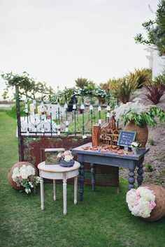 Found Vintage Rentals Gate , tables, birdcage and baskets make for a great Escort card display