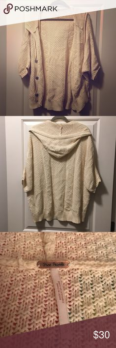 Free People Oversized Knit Hooded Sweater VERY oversized. It is a SMALL, but it's so oversized that I want to put medium. Just way too big on me, I'm a size 4-6. Never worn. Silver clip buttons up the front so you can close it. It's comfy and cute. Smoke free home. Free People Sweaters