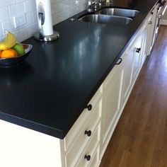 absolute black honed granite in kitchen either on perimeter countertops - if leathered or antiqued available, also good option - hides fingerprints Eclectic Kitchen, Kitchen Remodel, Kitchen Tiles Design, New Kitchen, Best Kitchen Countertops, Black Granite Kitchen, Kitchen Renovation, Black Granite Countertops, Outdoor Kitchen Countertops