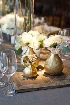 gold vases photo by aaron delesie
