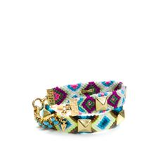 Lisette Turquoise  A summer staple, and all grown up, the Lisette bracelet is a mature take on the friendship bracelet. Featuring gold studs, turquoise pave crystals, and arrowhead charm details Lisette ensures your look is nostalgic, unique and fun!!