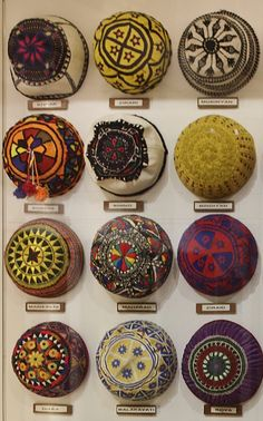 Kurdish traditional men's caps. 20th century. The names beneath each of them give the tribal or geographical origin. (Kurdish Textiles Museum, Erbil, northern Iraq).