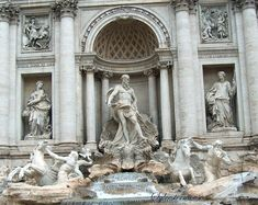"""Trevi Fountain - Inscription above says """"POSITIS SIGNIS ET ANAGLIPHIS TABULIS IUSSU CLEMENTIS XIII PONT. MAX. OPUS CUM OMNI CULTU ABSOLUTUM A. D. MDCCLXII."""" Translation: The statues and the reliefs were decreed to be placed here by Clemens XIII Pontifex Maximus and the work was solved from every further work and care in the Year of the Lord 1762. (Source: http://www.trevifountain.net/description.htm)"""