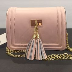 Powder pink tassel bag Italian leather Very cute bag made in Italy. Powder Pink Tassel Italian Leather bag with golden chain. Size 21x14x7 cm Bags Shoulder Bags