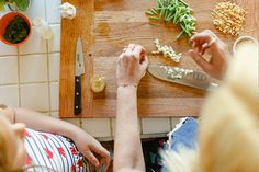 family cooking with blue apron meals