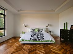 herringbone wood floor Bedroom Contemporary with black and white black dresser…