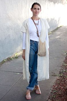 10 Wildly Cool Looks Spotted At A Craft Fair #refinery29  http://www.refinery29.com/la-style#slide17  Kristen Caissie, florist Vintage Levi's 501s, Black Crane duster, K Jacques sandals, Gap shirt.