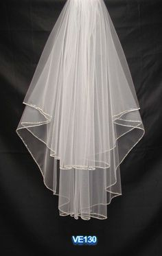 Two tiers waist length long with beading bridal veil.. But ivory..?