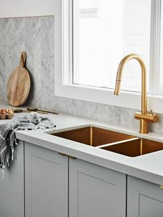 The norsuHOME - Kitchen Photographer: Lisa Cohen Stylist: Beck Simon  Tiles: Perini Tiles Cabinetry: kaboodle Kitchens Flooring: Godfrey Hirst  Benchtop: Caesarstone Appliances: Smeg Tapware: Sussex Taps Sink: ABI Interiors