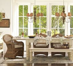 Love all the light, the white table & bench with wicker chairs..~ Just love