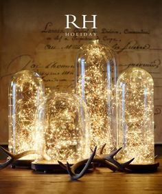 Glass cloches filled with twinkling fairy lights