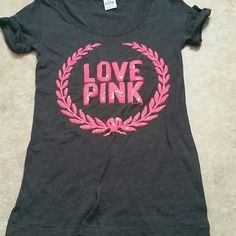 PINK T Excellent used condition. No holes. No stains. No pilling. Tag lists this as an xs. Fits like Small. Has a straight cut. Measures 14 inches from pit to pit. Sequence are in excellent condition and are a pinkish/coral color   Please make offers thru the OFFER TAB ONLY.  Bundles receive 15 % off using bundle feature.   No trades  No other sites  No modeling   (30) PINK Victoria's Secret Tops Tees - Short Sleeve