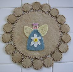 This is a cute little garden angel penny rug for spring or summer decor.  It can be used in any room.    size is 10 round    colors are lt.
