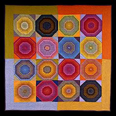 ALL ABOUT OCTAGONS by Catherine Conkey.  This quilt was created using designer Kaffe Fassett's striped fabrics and shot cottons