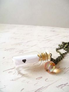 apothecary bottles..roll paper inside-plus some sand..have each guest write a special message to the bride
