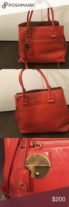 """Marc Jacobs Tote Marc Jacobs Medium Apple Waxed leather tote. In good condition. Beautiful Italian leather.  Hardware is antique gold. Dimensions H12"""" x W19"""" x D7"""" shoulder strap drop 20"""" and handle drop 8"""". Included crossbody strap. Burnt orange color. It's really beautiful Marc Jacobs Bags Totes"""