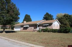 ALL-BRICK 2 BR HOME in Northern Hills. Den behind kitchen, living room with gas fireplace. Covered patio overlooking fenced backyard with garden area. Wide lot with room on the side. Vinyl tilt-in windows in most of the home. Roof new in 2009, H/A in 2010. Priced right! in Mountain Home AR
